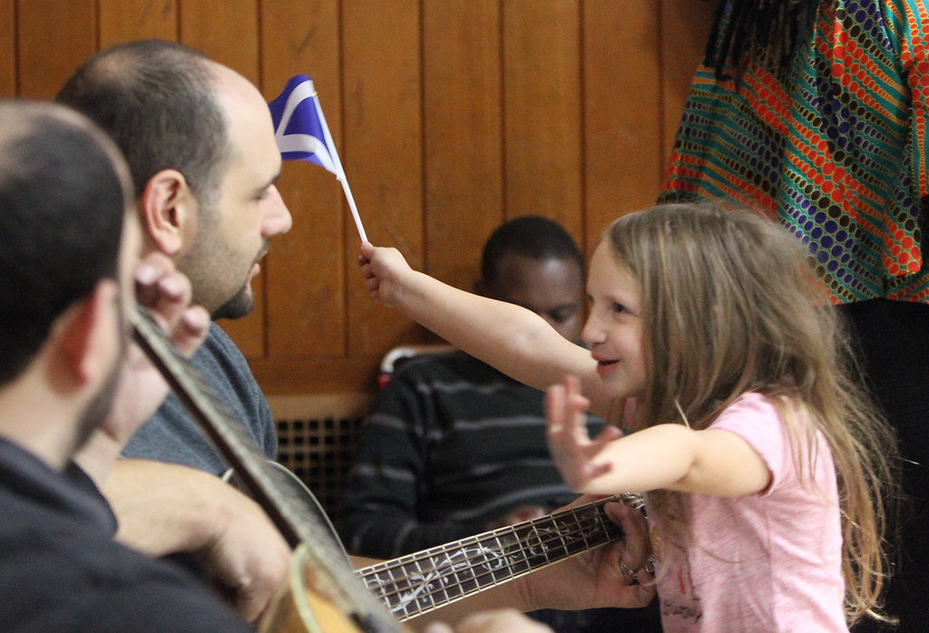 . South Row School International Festival in Chelmsford. Claire Alex, right, a kindergarten student at South Row, with her father John Alex playing bass guitar. (SUN/Julia Malakie)
