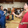 South Row School International Festival in Chelmsford. Anu Gudbole, left, and Sowmya Angadi, both of Chelmsford and South Row parents, dance the dhandiya, a Northern Indian form of dance with sticks to make noise. (SUN/Julia Malakie)