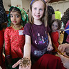 South Row School International Festival in Chelmsford. Lillian Abbott, 7, of Chelmford, showing her henna painted hand, with her mother Tammy Abbott and sister Evelyn, 4, rear, and 1st grader Dviti Patel, 7, left. (SUN/Julia Malakie)