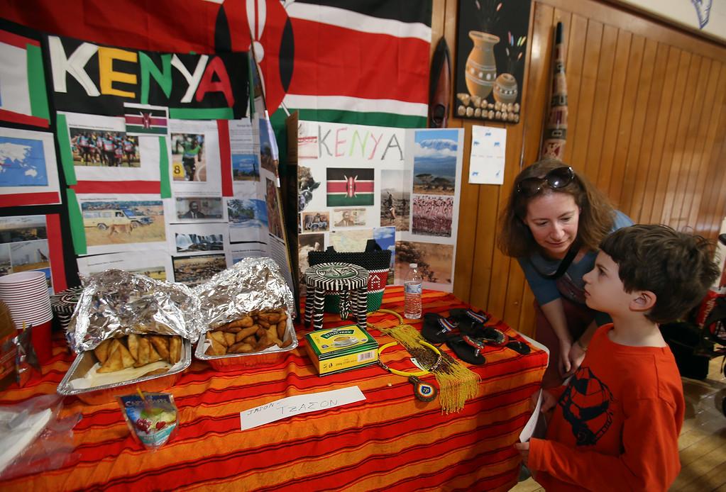 . South Row School International Festival in Chelmsford. Erika Wissinger of Chelmsford and her son Alfie Zanich, 6, a kindergarten student, look at Kenya exhibit. (SUN/Julia Malakie)