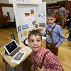 South Row School International Festival in Chelmsford. Harrington Elementary School kindergarten student Hayden Hunnewell, 6, front, with his brother, South Row 2nd grader Hunter Hunnewell, 8, who was passing out pretzel samples at the Germany booth. (SUN/Julia Malakie)