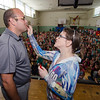 Shannon Kessler covers South Street Elementary Principal Jon Thompson with some red lipstick before planting a kiss on Otis the pig during the last school assembly of the year on Wednesday morning. Thompson has previously promised his school that he would kiss a pig if they read over one million pages of book during the school year. SENTINEL & ENTERPRISE / Ashley Green