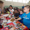 South Street Elementary students pick out books during the last school assembly of the year on Wednesday morning. SENTINEL & ENTERPRISE / Ashley Green
