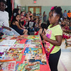 South Street Elementary student Semaya Young picks out a book during the last school assembly of the year on Wednesday morning. SENTINEL & ENTERPRISE / Ashley Green