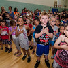 South Street Elementary students stand for the Pledge of Allegiance during the last school assembly of the year on Wednesday morning. SENTINEL & ENTERPRISE / Ashley Green