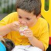 The City of Leominster held a ribbon cutting for the new playground on Vicoloid Avenue next to the Southeast Elementary School on Wednesday afternoon.  After the ribbon cutting all the kids got to have some ice-cream and Cameron Card, 6, seem to really enjoy his. SENTINEL & ENTERPRISE/JOHN LOVE