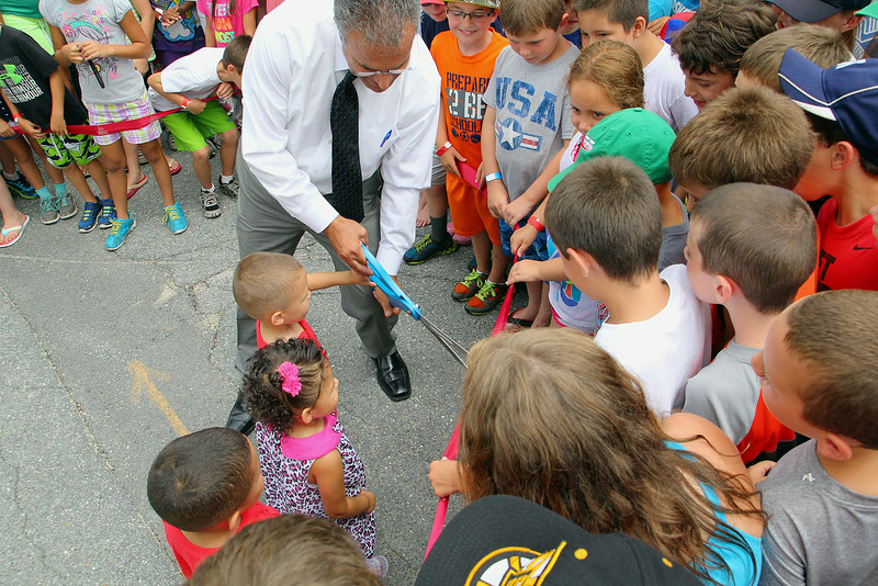 The City of Leominster held a ribbon cutting for the new playground on Vicoloid Avenue next to the Southeast Elementary School on Wednesday afternoon. Mayor Dean Mazzarella had some help cutting the ribbon from siblings Eddie Melendez Jr., 4, Mariani, 2, and Jeddiel, 5. SENTINEL & ENTERPRISE/JOHN LOVE