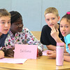 The first ever book battle was held at the Southeast Elementary School in Leominster on Monday. Team DelGreco wait to see if their answer was right o one of the questions during the battle. From left is Tyler Bedard, 11, Abigal Chambass, 10, Christian Snyder, 11, and Lerysneth Perez, 12. SENTINEL & ENTERPRISE/JOHN LOVE