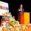 """U.S. Rep. Jim McGovern talks to St. Bernard's High School students about the national hunger problem, Thursday in Fitchburg. Students at the school recently watched """"A Place at the Table,"""" a documentary on hunger by makers of """"Food Inc."""" in which Rep. McGovern appears in. The food displayed was collected by the students and will be going to St. Vincent de Paul.<br /> SENTINEL & ENTERPRISE / BRETT CRAWFORD"""