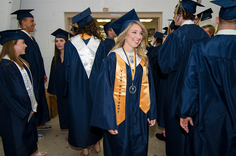 Hannah Bagley, Vice President of the Class of 2016, waits for the start of the graduation ceremony at St. Bernard's on Friday evening. SENTINEL & ENTERPRISE / Ashley Green