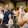 AJ Robichaud gets congratulations from cousins Sophia and Ella Krook following the 90th commencement ceremony at St. Bernard's on Friday evening. SENTINEL & ENTERPRISE / Ashley Green