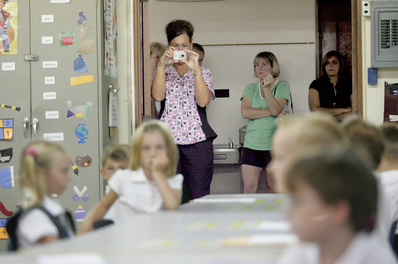 E.L. Hubbard Photography<br /> Parents watch from the hallway and take pictures as their kindergarteners settle in for the first day of classes at St. Joseph.