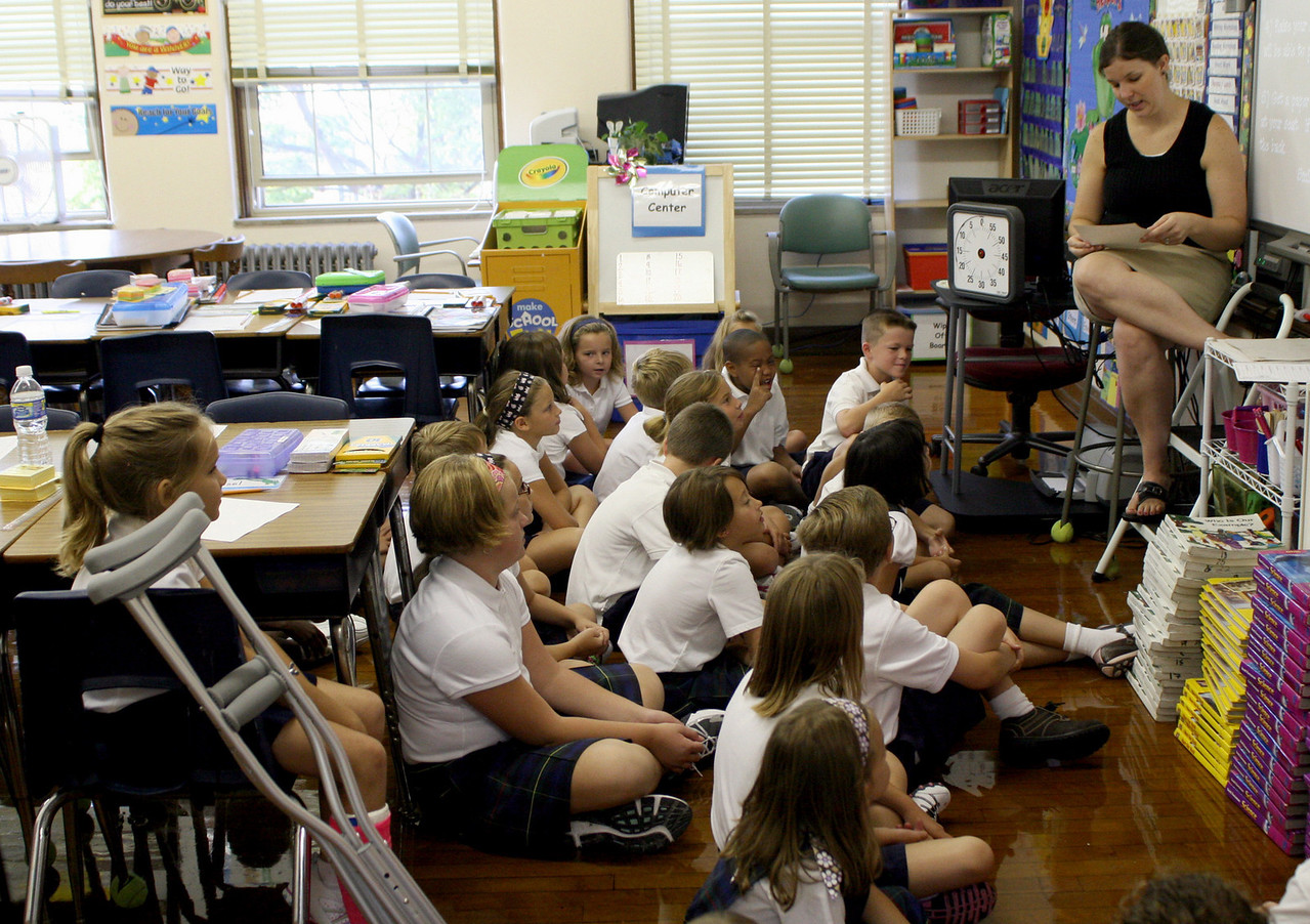 E.L. Hubbard Photography<br /> Third-graders listen to teacher Meredith Schroeder on the first day of school at St. Joseph.
