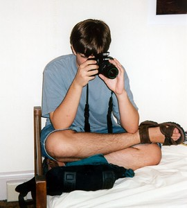 Jon on bed with camera