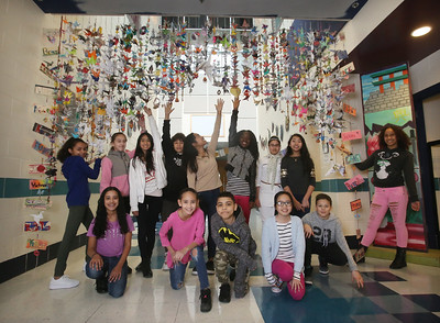 Students at the Stoklosa Middle School made over 1,000 paper cranes in an art project, with each student making at least one, to promote peace and other wishes. Left to right, front: Yuliana Lugo, Knalee Ortega, Luis Gomez, Thu Vu, and Israel Rentas. Rear: Ariana Santiago, Nina Morales, Julie Sok, Christian Montalvo, Daryan Kong, Celia Flomo, Fatema Ahmad Ali, Jennifer Thok and Bianca Jimenez. (SUN/Julia Malakie)
