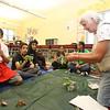 Sally Farrow, teacher/naturalist from Mass Audubon's Drumlin Farm, shows cecropia caterpillars to kids in Stoklosa Middle School Summer Program, including Victor Miranda, 12, left. (SUN/Julia Malakie)