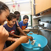 Stoklosa Middle School Summer Program. Stoklosa Middle School Summer Program. From left, Analyse Palomares, 11, Andres Cuartas, 11, Joseph Songolo, 10, and Eduardo Bizaldi, 12, see how many marbles their aluminum foil boats will hold before sinking, in a Summer STEM Challenge. (SUN/Julia Malakie)(SUN/Julia Malakie)