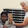 Sally Farrow, teacher/naturalist from Mass Audubon's Drumlin Farm, shows an Eastern screech owl to kids in Stoklosa Middle School Summer Program, including Eliane Amani, 11, left. (SUN/Julia Malakie)