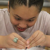 """Stoklosa Middle School Summer Program. Kayla Rivera, 10, does """"Kitchen Chemistry"""", using milk, food coloring and Dawn detergent as a catalyst to make swirling designs. (SUN/Julia Malakie)"""