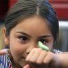 Stoklosa Middle School Summer Program. Serenity Meas, 11, looks at a cecropia caterpillar. (SUN/Julia Malakie)
