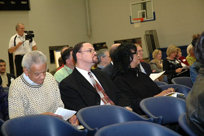 Dr. Brown (glasses) and wife take in the information being presented.