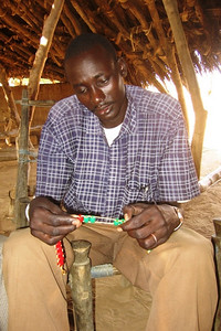 Angelo, the headmaster of Wunlang School, demonstrates the use of a bead abacus.