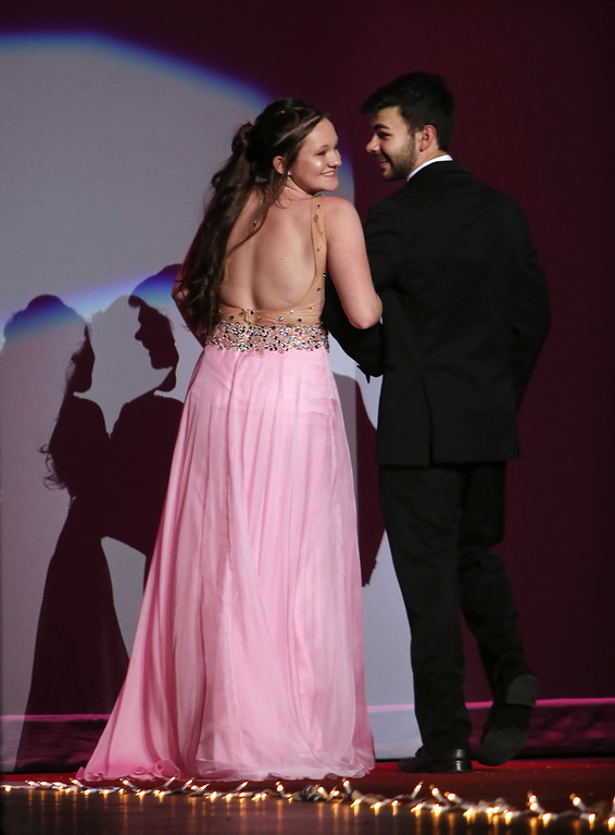 . Emily Woods and Peter Tsaousis, in Tewksbury Memorial High School DECA\'s annual fashion show, to benefit the Meghan McCarthy Research Fund for reseach on pediatric brain tumors.  (SUN/Julia Malakie)