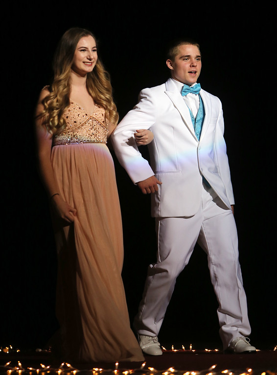 . Stephanie Bourgeois and Nolan Kavanaugh in Tewksbury Memorial High School DECA\'s annual fashion show, to benefit the Meghan McCarthy Research Fund for reseach on pediatric brain tumors.  (SUN/Julia Malakie)