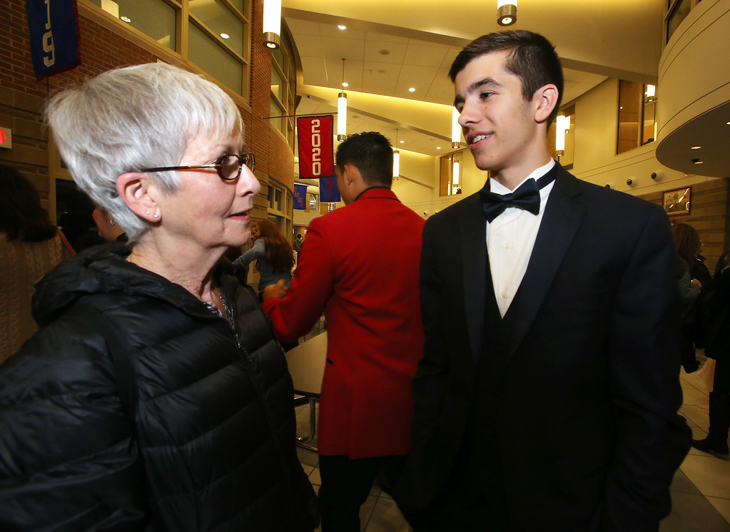 . Tewksbury Memorial High School DECA\'s annual fashion show, to benefit the Meghan McCarthy Research Fund for reseach on pediatric brain tumors. Cam Kelly with his grandmother Becky Kelly of Tewksbury, after the show.  (SUN/Julia Malakie)