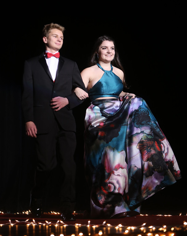 . MacLean and Molly Hodgson, in Tewksbury Memorial High School DECA\'s annual fashion show, to benefit the Meghan McCarthy Research Fund for reseach on pediatric brain tumors.  (SUN/Julia Malakie)
