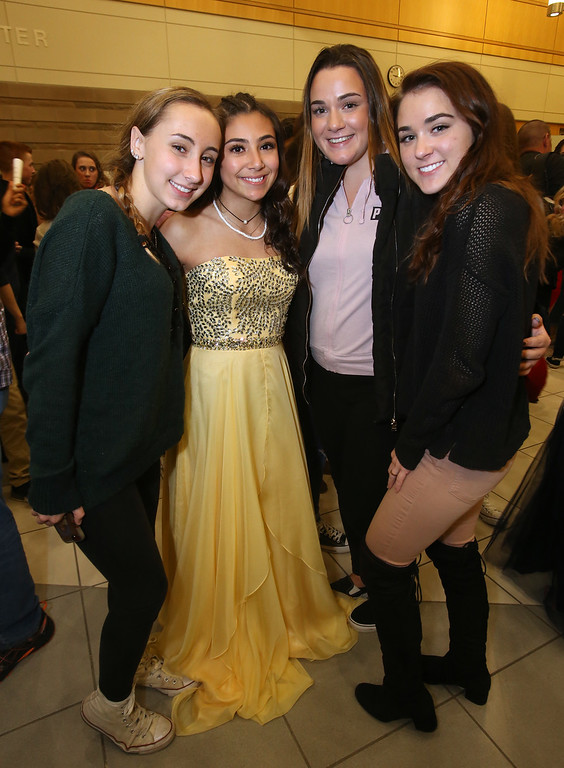 . Tewksbury Memorial High School DECA\'s annual fashion show, to benefit the Meghan McCarthy Research Fund for reseach on pediatric brain tumors.  From left, sophomore Laura Countie, sophomore Gianna DiGiorgio, senior Sydney Quinn and junior Calli Kavanaugh.  (SUN/Julia Malakie)