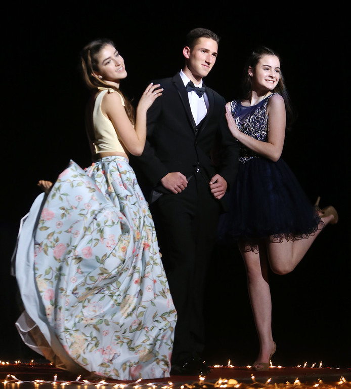 . From left, Rebecca DeFrancesco, David Durant and Grace Morris, in Tewksbury Memorial High School DECA\'s annual fashion show, to benefit the Meghan McCarthy Research Fund for reseach on pediatric brain tumors.  (SUN/Julia Malakie)