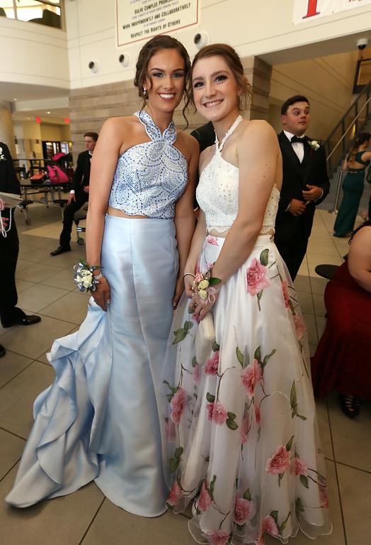 . Pre-prom procession at Tewksbury High School. Lauren Lamoureux, left, and Leanne Durham. (SUN/Julia Malakie)