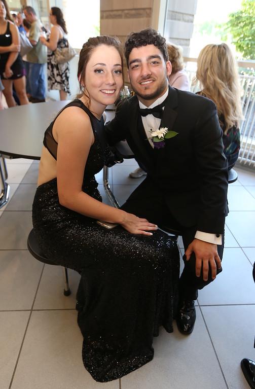 . Pre-prom procession at Tewksbury High School. Erin Gallella and Shane Darrigo. (SUN/Julia Malakie)