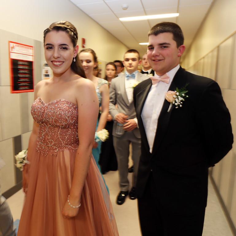 . Pre-prom procession at Tewksbury High School. Gabrielle Vitiello and Brian Dankese. (SUN/Julia Malakie)