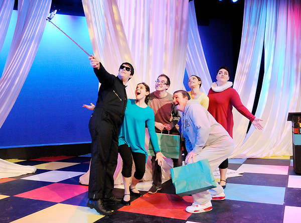 """Don Knight   The Herald Bulletin<br /> Cast members pose for a selfie with audience members after the audience portrayed Ophelia in Anderson University's production of """"The Complete Works of William Shakespeare (Abridged)."""""""