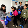 "Casey student, Cyndi Ordaz, left, presents  a gift to Baiyang, of the delegation.<br /> A delegation from Tibet, organized by the Boulder-Lhasa Sister City Project, visited Casey Middle School on Tuesday. For more photos and a video of the delegation, go to  <a href=""http://www.dailycamera.com"">http://www.dailycamera.com</a>.<br /> Cliff Grassmick/ February 22, 2011"