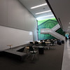 Interdisciplinary space at the new Billerica Memorial High School, with a photo of the old Howe School on the wall. (SUN/Julia Malakie)