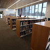 Bookshelves are being filled in the Library of the new Billerica Memorial High School. (SUN/Julia Malakie)