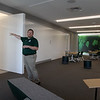 Superintendent Tim Piwowar gives a tour of the new Billerica Memorial High School. Classrooms open onto this interdisciplinary space. The rear wall is a photo of JFK visiting Billerica. (SUN/Julia Malakie)