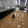 Tour of the new Billerica Memorial High School. Screens can be lowered to divide the gym into three areas including the competition gym at left, and two narrower courts at either side. (SUN/Julia Malakie)
