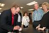 Baseball Hall of Fame catcher Jim Sundberg autographs a baseball for Jordan and Carla Wilton of Weatherford.