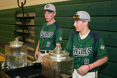 TCA Eagles pitcher Payne Roewe (left) and shortstop Calib Guyne were among the baseball players who volunteered as servers at the event.