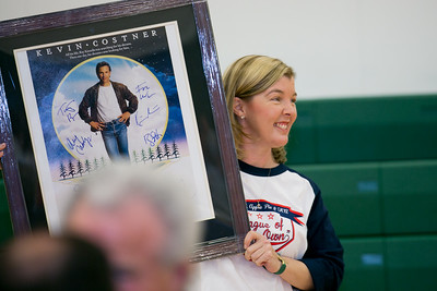"Tiffany Hornick holds a ""Field of Dreams"" movie poster autographed by cast members which was auctioned for $900."