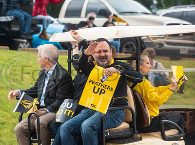 """Tyler Junior College President Dr. Juan E. Mejia waves as he rides around the campus in Tyler with class of 2020 graduates as part of a """"victory lap"""" drive-through celebration for the May 2020 graduating class on what should have been Tyler Junior College's spring graduation day, Friday May 8, 2020. May commencement has been postponed to August with details pending at this time."""
