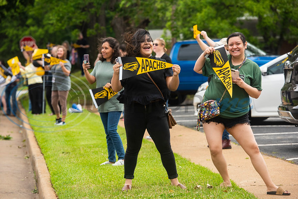 """People space themselves apart and cheer as Tyler Junior College students ride in vehicles around the campus in Tyler as part of a """"victory lap"""" drive-through celebration for the May 2020 graduating class on what should have been Tyler Junior College's spring graduation day, Friday May 8, 2020. May commencement has been postponed to August with details pending at this time."""