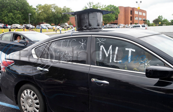 """A car with a makeshift graduation cap on top lines up for TJC's """"victory lap"""" drive-through celebration for the May 2020 graduating class on what should have been Tyler Junior College's spring graduation day, Friday May 8, 2020. May commencement has been postponed to August with details pending at this time."""