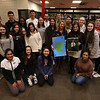 Tyngsboro High School's Student Council, meets with organ donation advocate Sandra Dubuc of Hudson, N.H., a day before National Organ Donor Day on February 14, including officer Natalie Barros, 17, of Tyngsboro, a junior, holding a photo of Dubuc's son Matty, who died of cancer at age 7 in 2007 but lived two years extra thanks to a liver transplant. Students have been sending ecards to kids awaiting transplants at Children's Hospital, and gave Dubuc a card full of valentine notes. (SUN/Julia Malakie)