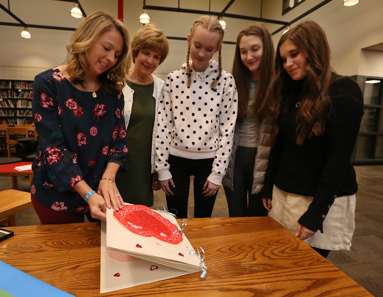 Tyngsboro High School's Student Council, meets with organ donation advocate Sandra Dubuc of Hudson, N.H., a day before National Organ Donor Day on February 14. From left, Sandra Dubuc, Student Council advisor Deborah Teal, and Student Council officers, senior Cate Barton, 17, and juniors Naama Perliger, 16, and Natalie Barros, 17. Students gave Dubuc a card full of valentine notes. (SUN/Julia Malakie)