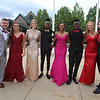 Tyngsboro High pre-prom gathering at Tyngsborough Elementary School. From left, Michael Soucy, Olivia Campbell, Jenna Collinge, Javaughn Beal, Shya Familia, Brendan Cole, Kellie Martin and Stephen Chisholm. (SUN/Julia Malakie)